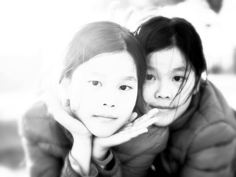 This black and white portrait of twins was created from a color photograph, using PicMonkey's tools.
