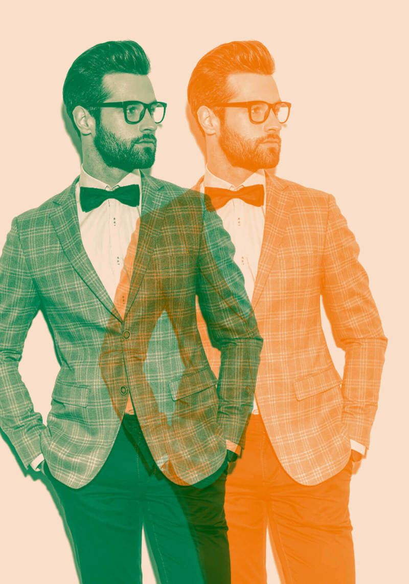 Double color exposure image of a smartly dressed, dapper man.