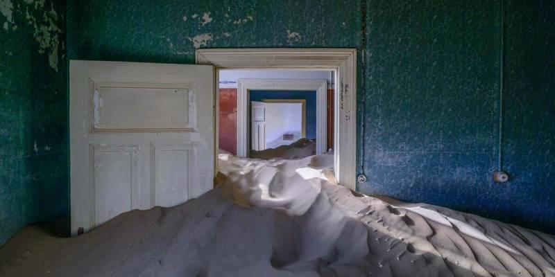 Sand piled high inside a building in Kolmanskop, an abandoned Namibian mining town.