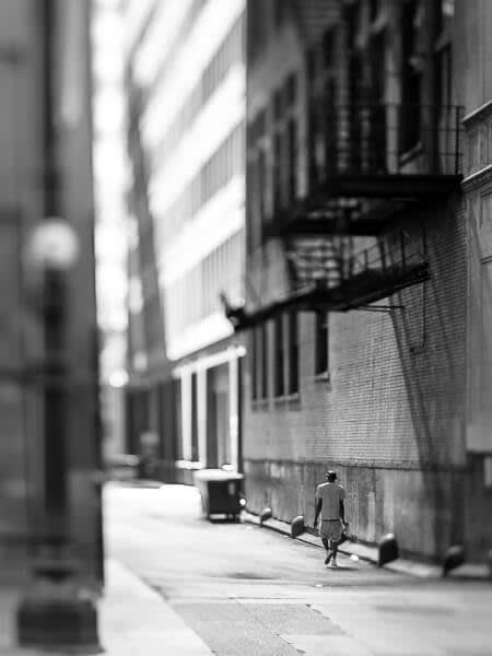This black and white photo of an alley was shot with a Lensbaby Edge 50 to get a miniature effect.