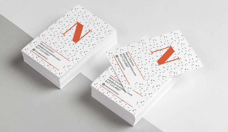 Professional business cards with an orange N on the front. Make your own business cards with PicMonkey.