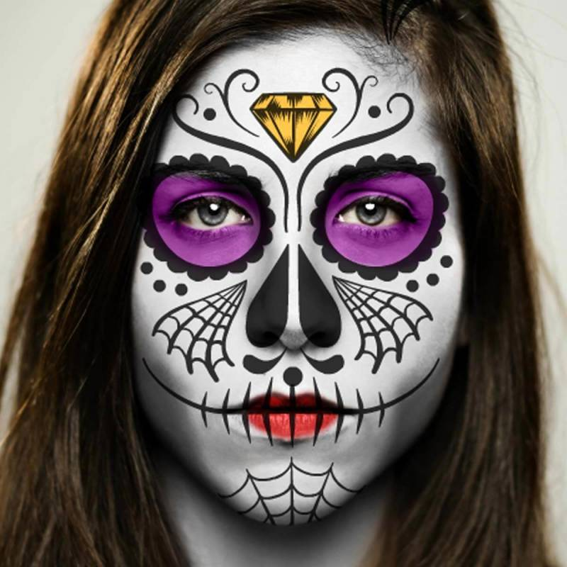 Day of the Dead makeup with spiderweb and gem embellishments.