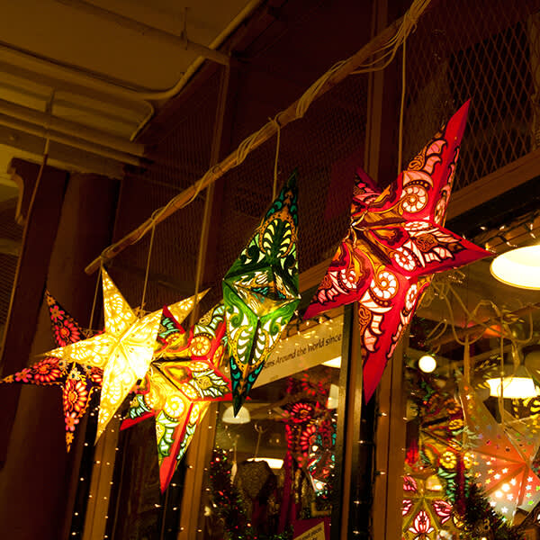 Staff photo walk: multicolored star lanterns suspended from a ceiling.