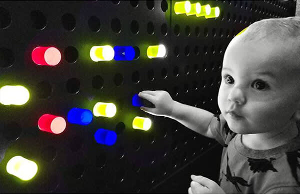 This picture of a child playing with a Lite Brite gets kicked up a notch with a color pop.