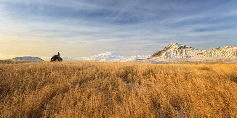 Iceland photos like this photo of a church in a grassy plain show the otherworldly grandeur of the environment