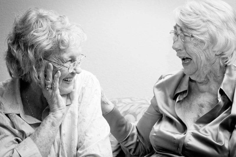 Photographer Erika Thornes shares tips on capturing joy, as seen in this picture of two women laughing.