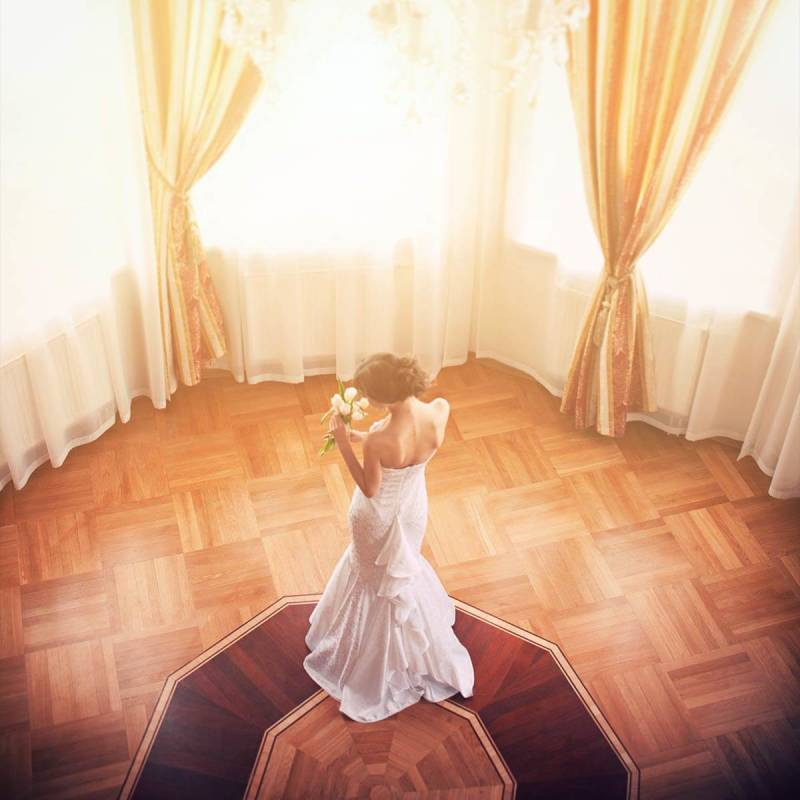 A picture of a bride standing in the middle of a room with ethereal writing, demonstrating correct Facebook image sizes.