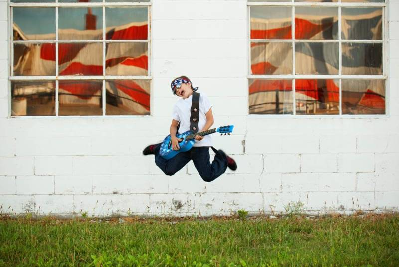 This kid knows how to rock a guitar! Photo by lwestphotos.com