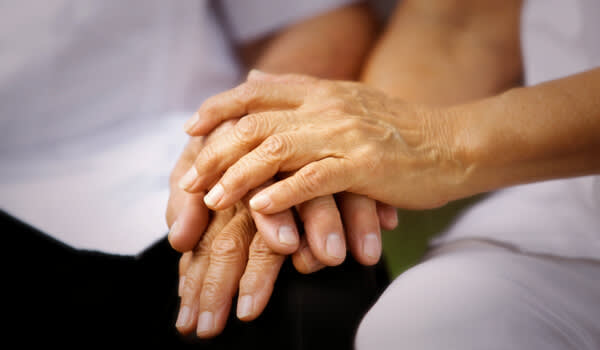 Photo of elderly hand holding for Valentine's Day.