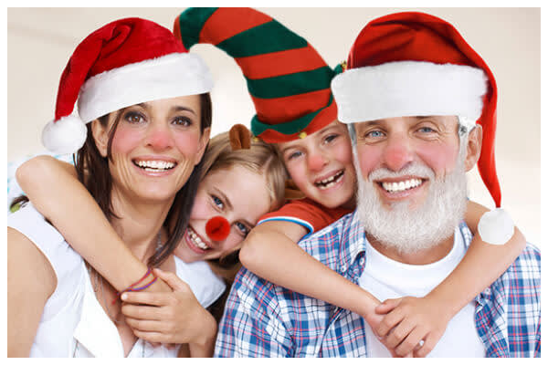 Various Santa costume graphics on four family members.
