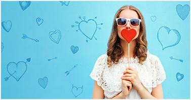 girl with sunglasses and heart cut out