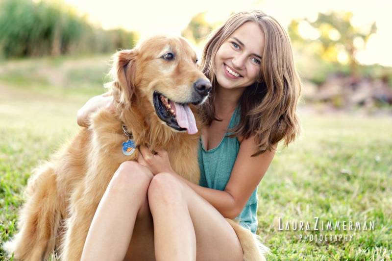 Why not make the family pet a part of senior photos? This smiling girl with a golden retriever make a pretty good pair.