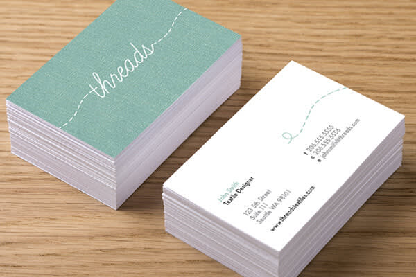 A stack of business cards, showing the business name