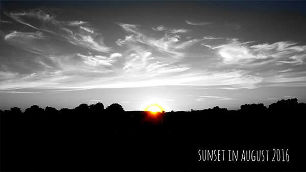 This black and white photo of a sunset gets kicked up a notch with a color pop.