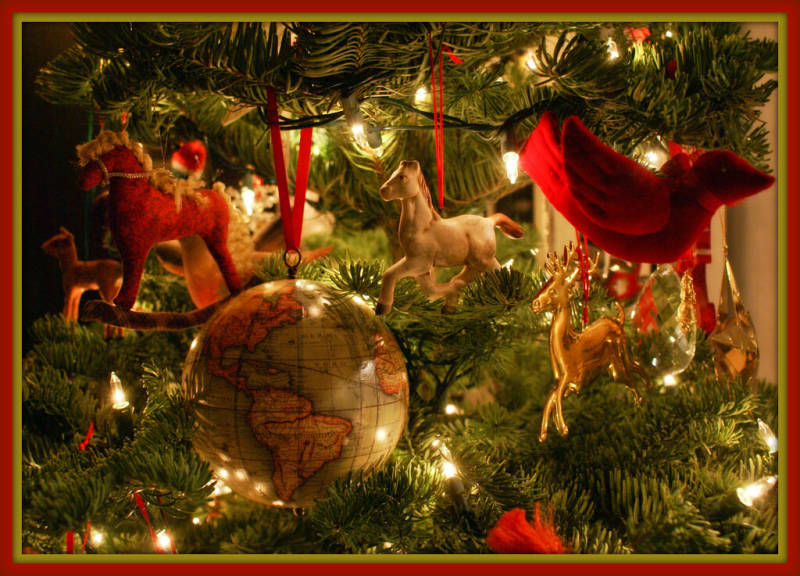 Christmas tree hung with bird, horse, and globe ornaments for our holiday photo contest.