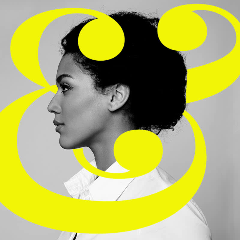Black and white side profile of woman with yellow ampersand layered for a 3D effect.