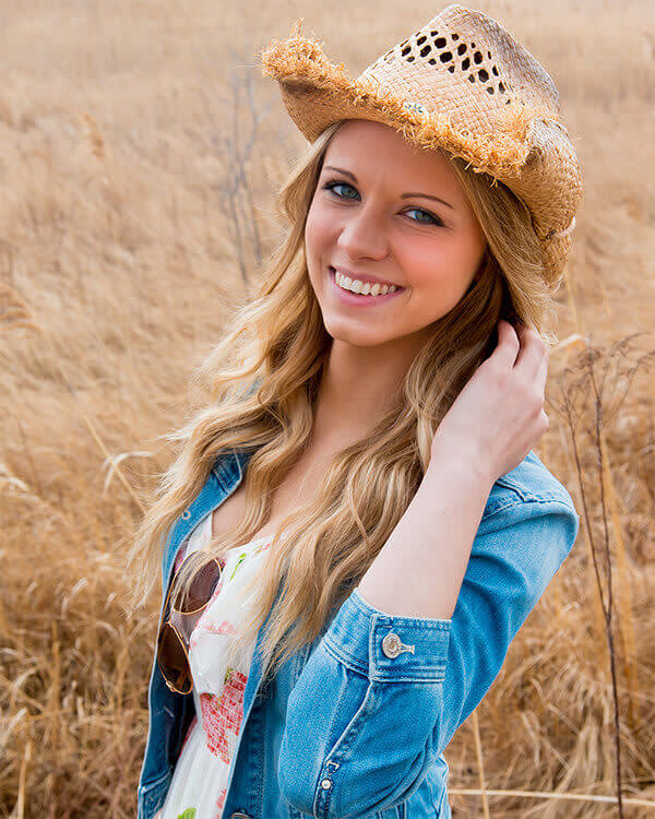 Learn how to get a great portrait—like this one of a blond woman in a cowboy hat—with tips from a professional photographer.