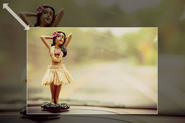 Properly resizing pics is one of PicMonkey's top 5 photo editing tips, as seen in this image of a hula dash doll.