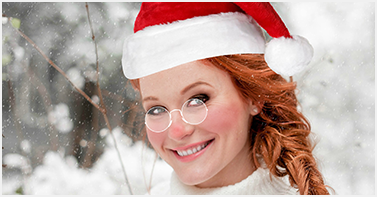 girl with santa hat on