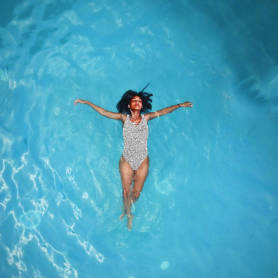 Instagram post template featuring woman floating freely in water