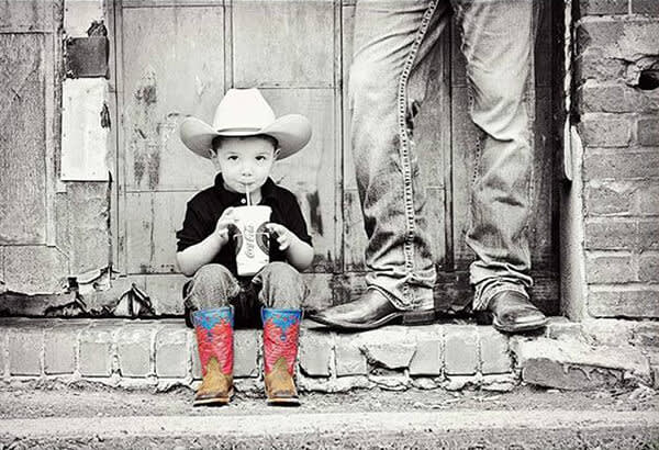 Boonoey Photography's black and white photo of a child in cowboy boots gets kicked up a notch with a color pop.