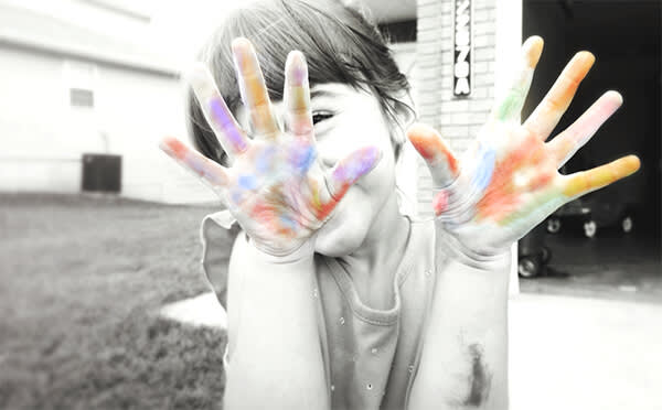 This black and white photo of a child gets kicked up a notch with bright colors of chalk on her hands. Make your own color pop pic with PicMonkey's tools.