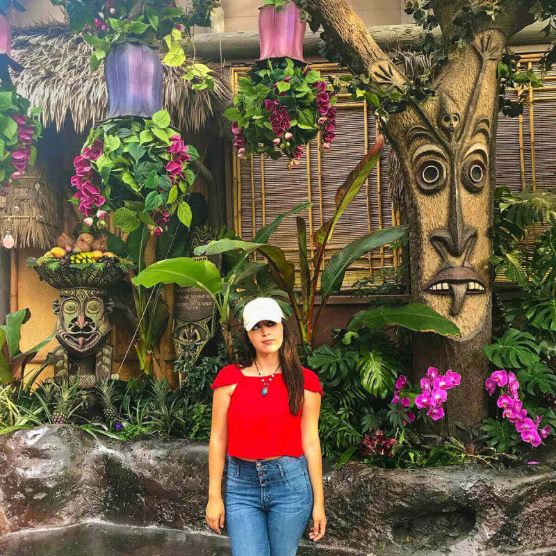 Young woman at the Enchanted Tiki Room in Disneyland