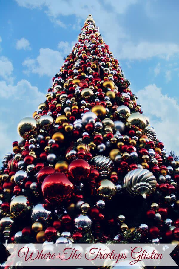 Christmas tree made entirely of red, silver, and gold ornaments, shot from below.