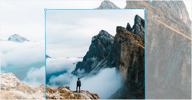 Person standing atop precipice, with image sized two ways using PicMonkey's Resize tool.