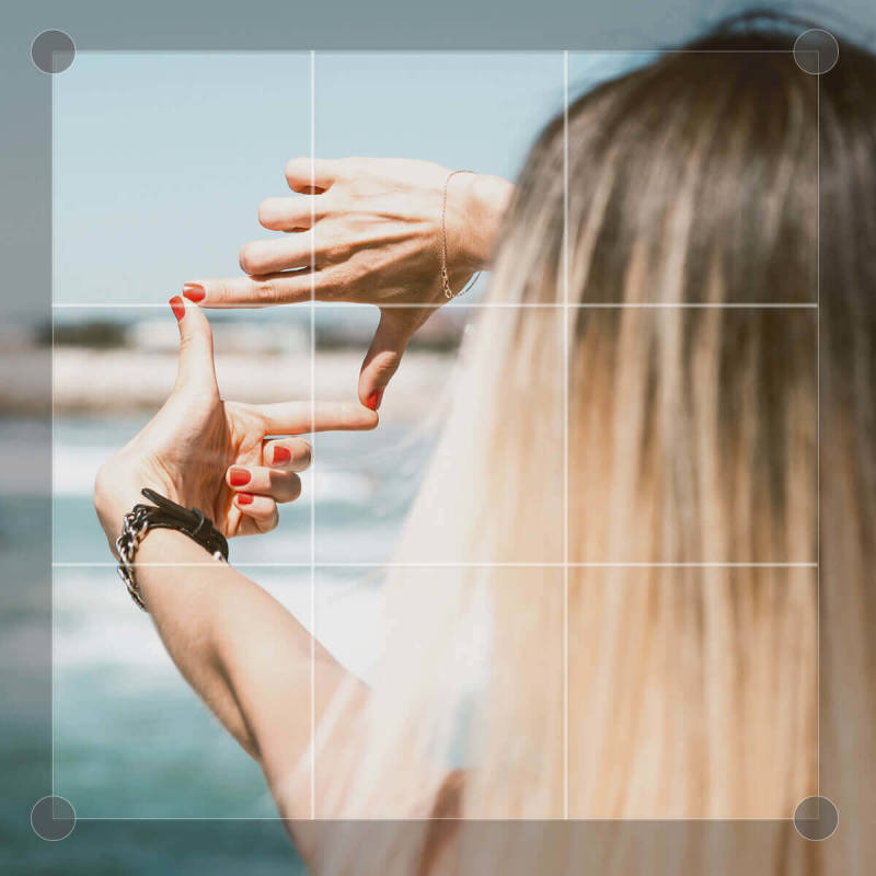 The rule of thirds grid can be used to crop a photo beautifully, as seen in this picture of a blond woman.