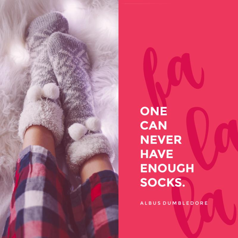 A pair of socked feet in pajamas.