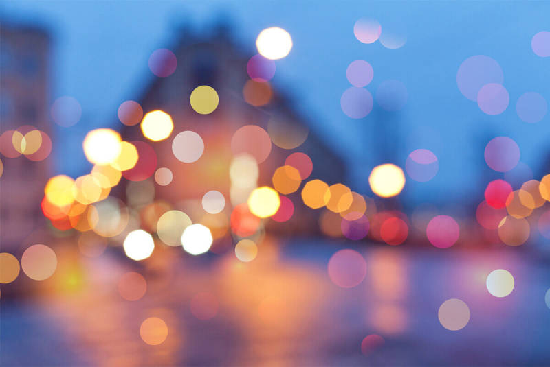 Add bokeh effects after the shutter snaps to get an artistic look, as seen with this blurry city shot.