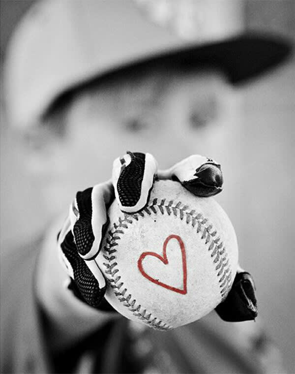 Boonoey Photography's black and white photo of a little boy with a baseball gets amped up with a red heart. Make your own color pop pic with PicMonkey's tools.