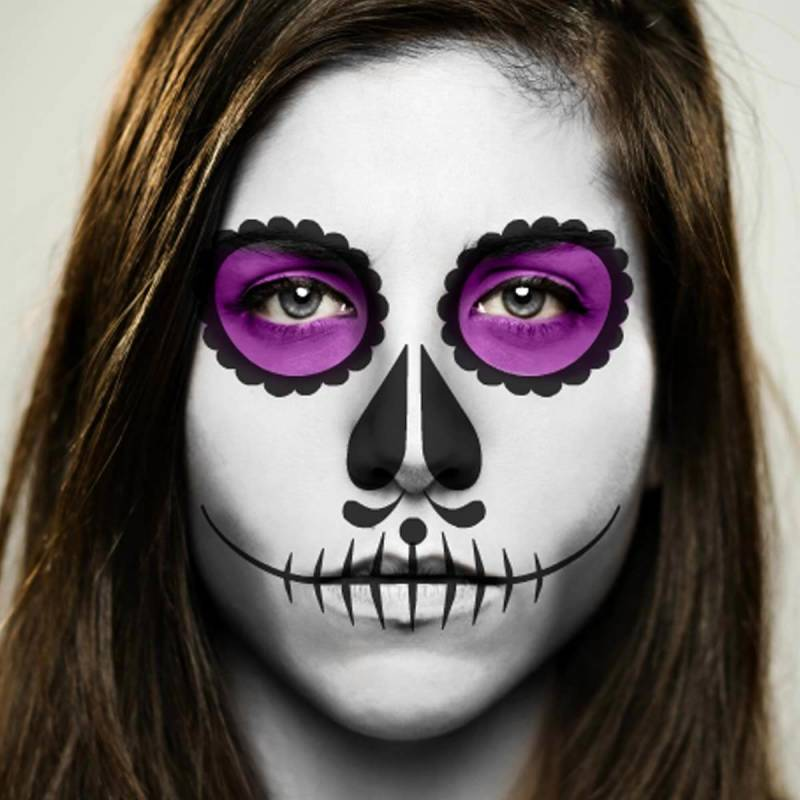 Day of the Dead makeup with stitch-like skeleton teeth effect.